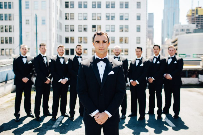 A group of groomsmen pose for wedding photography photos in Seattle