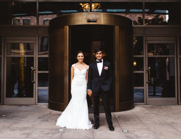 A couple smiles during their wedding at Hotel 1000 Seattle