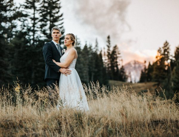 A couple watches the sunset on their wedding day at Mt. Hood