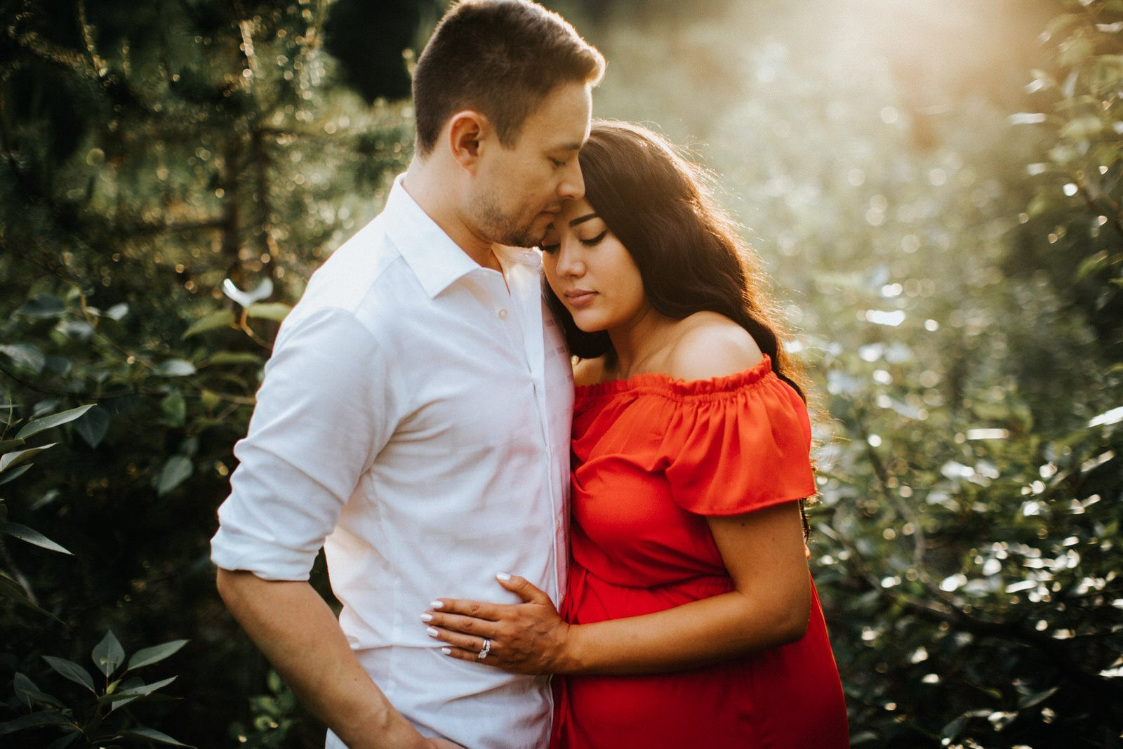 A gorgeous couple cuddles during their engagement session