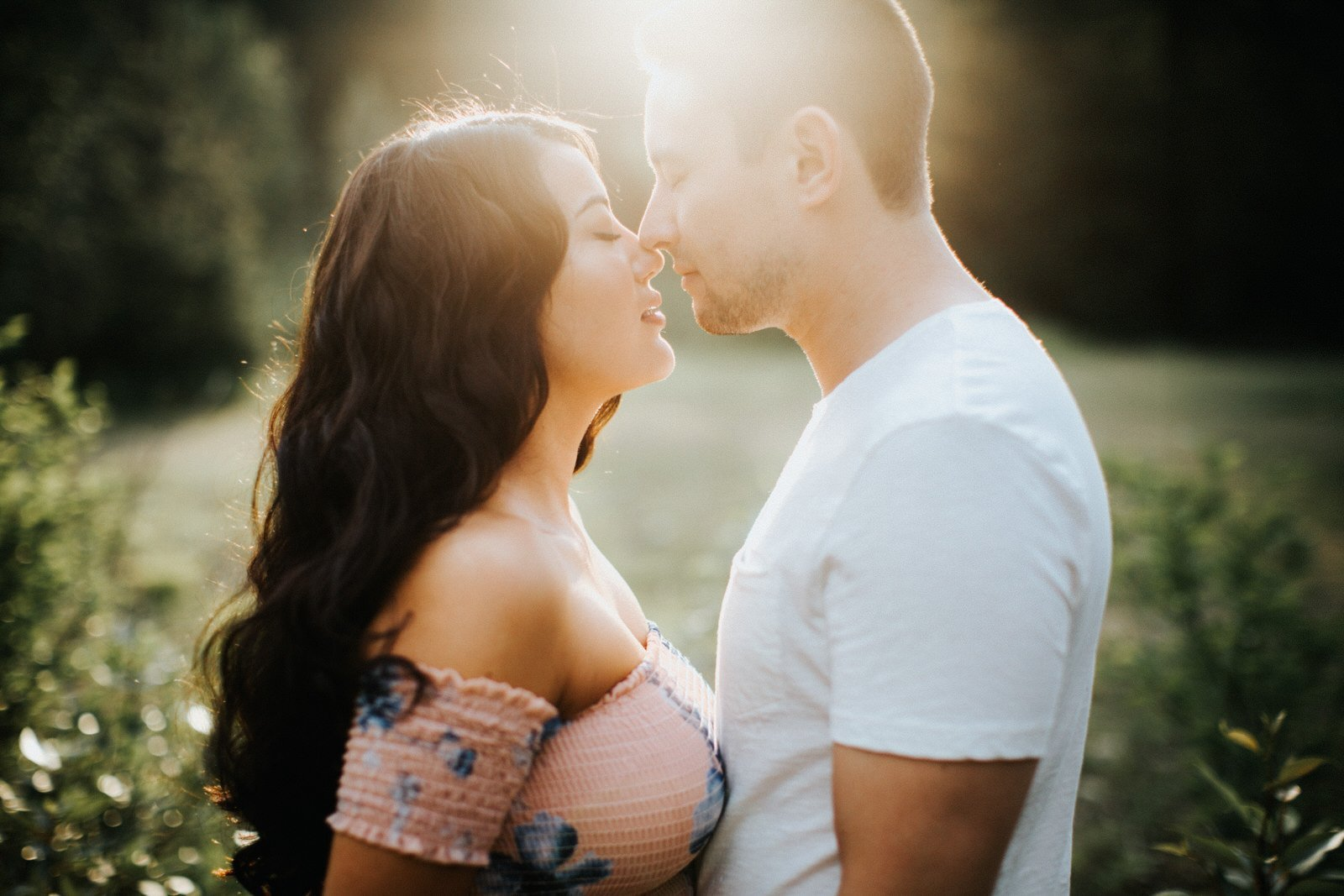Sunset flare during an engagement session