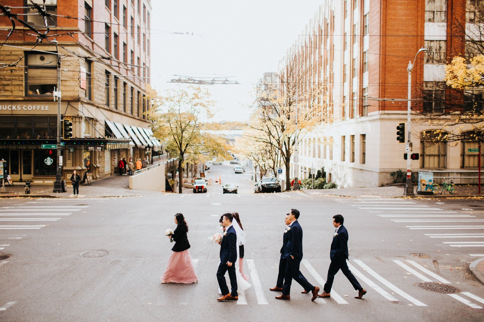 The wedding party walks downtown Seattle to pioneer square