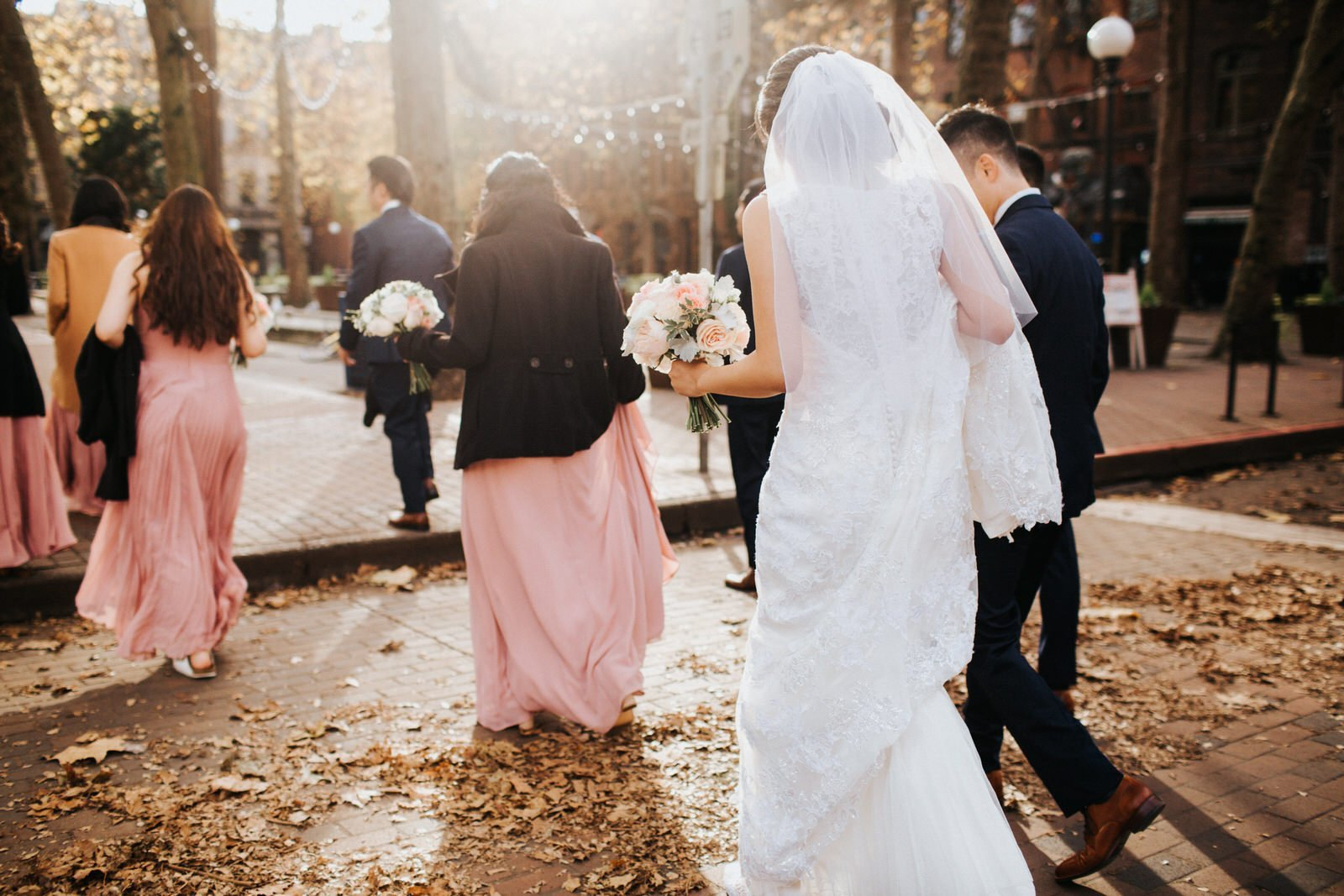 The wedding party walks into gorgeous light downtown seattle