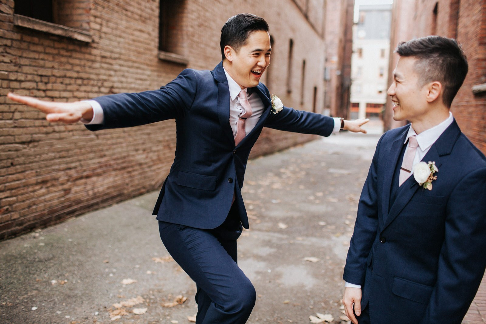 The groomsmen laugh and joke during photos