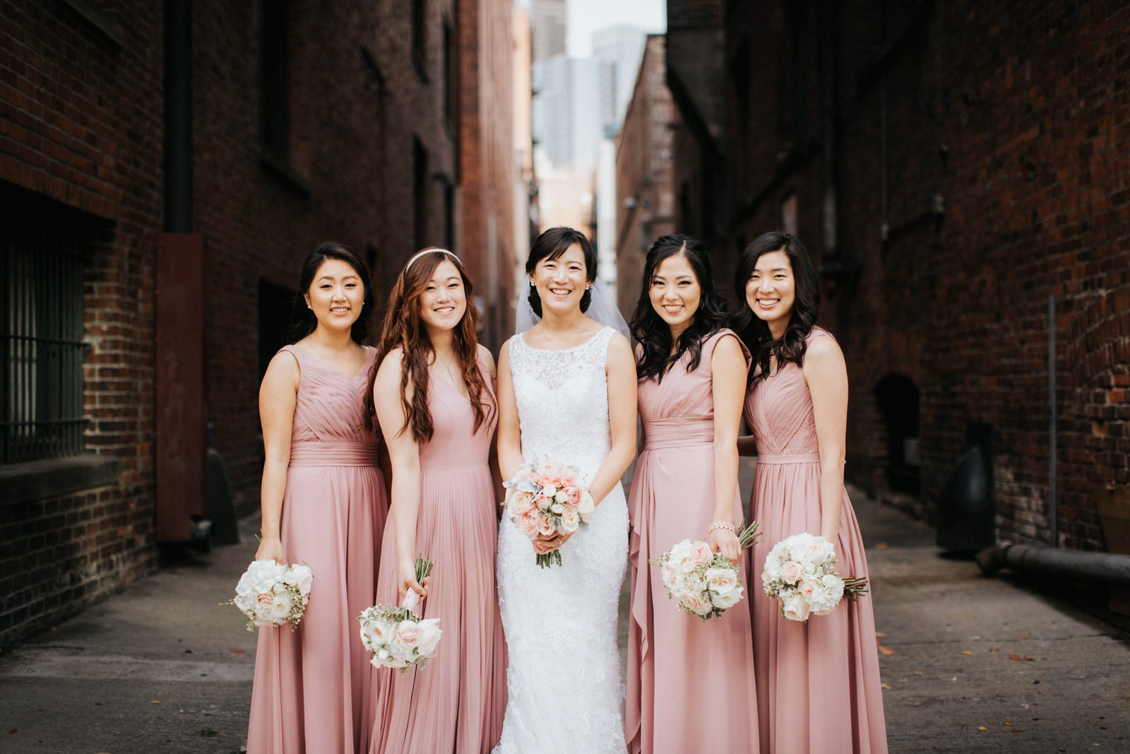 The bridesmaids pose during photos at pioneer square