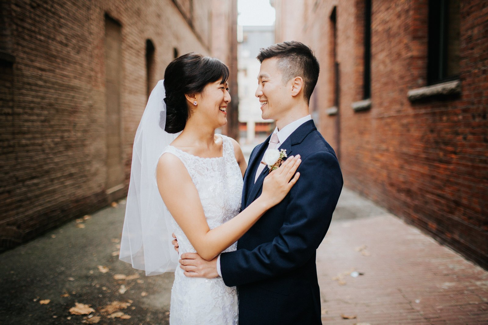 The couple poses in an alleyway in pioneer square during wedding photos at hotel 1000