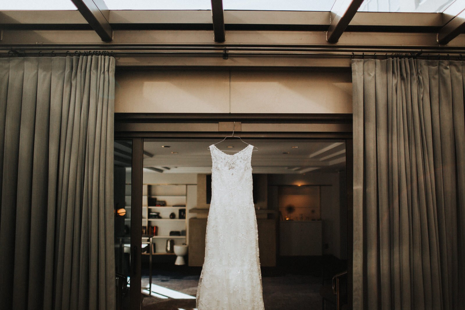 Wedding dress hanging up at hotel 1000 in Seattle