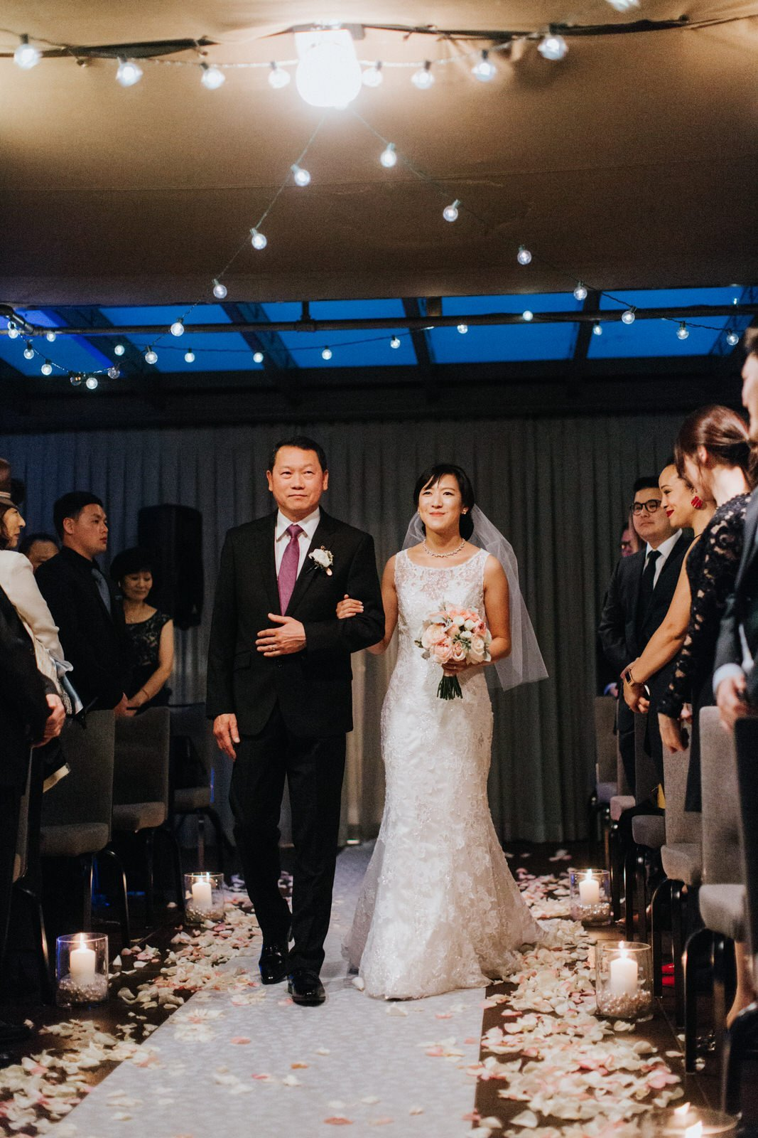 The groom walks his daughter, the bride, down the isle