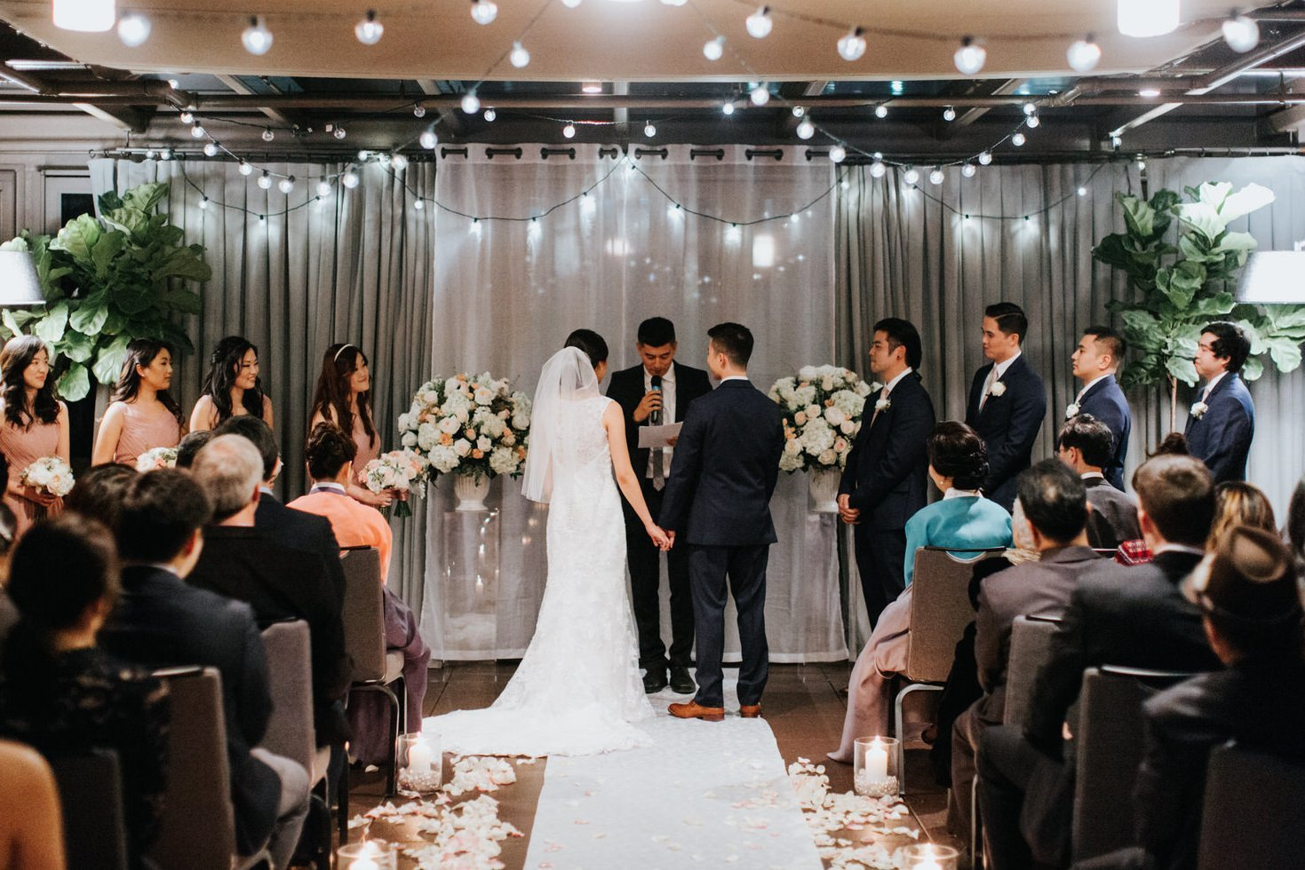 The couples stands during their wedding