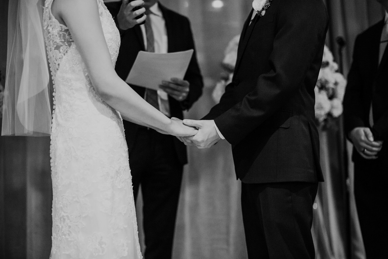 The couple holds hands during their night ceremony at hotel 1000