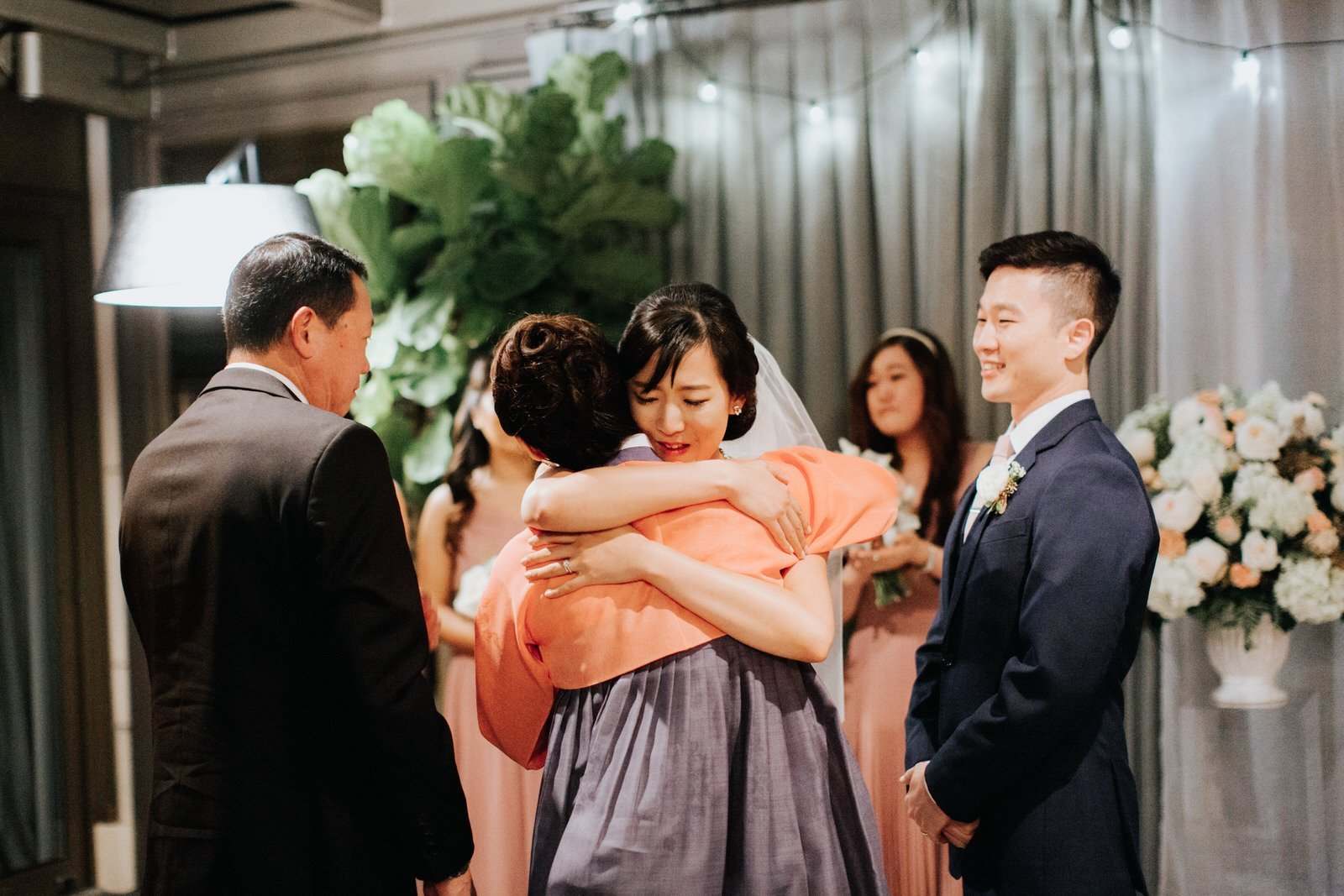 The bride hugs her mom during the ceremony at hotel 1000
