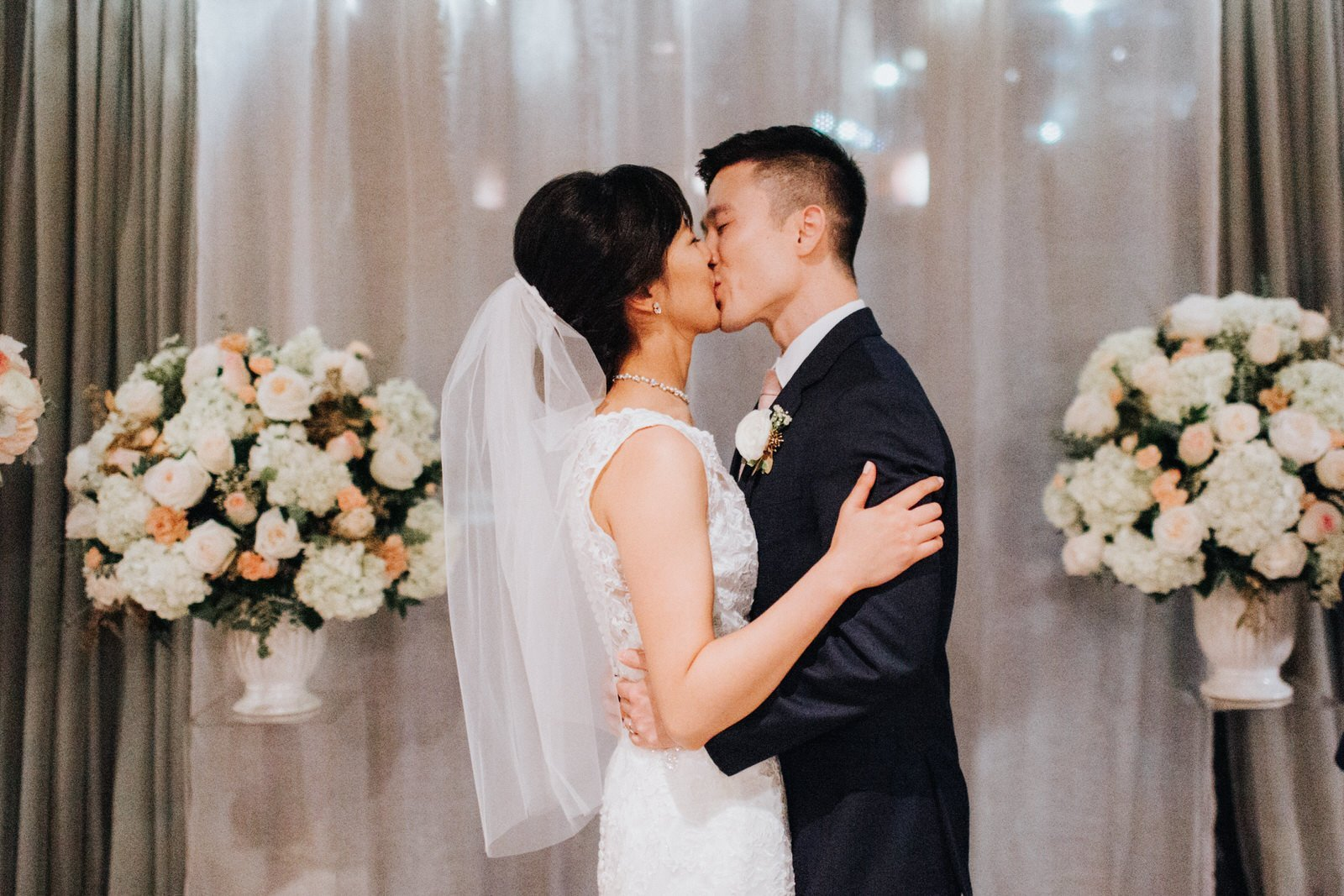 The couple kisses during their night ceremony at hotel 1000