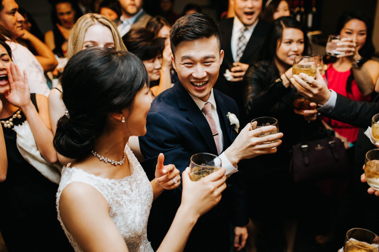 The couple drinks with their guests during the reception