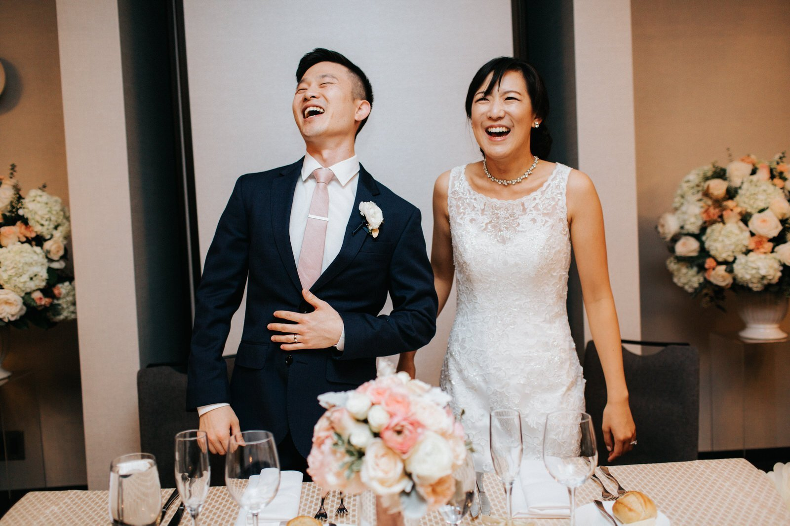 The couple laughs during their reception