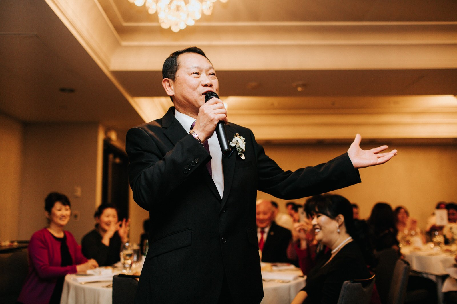 The father of the bride gives a speech during the reception at hotel 1000