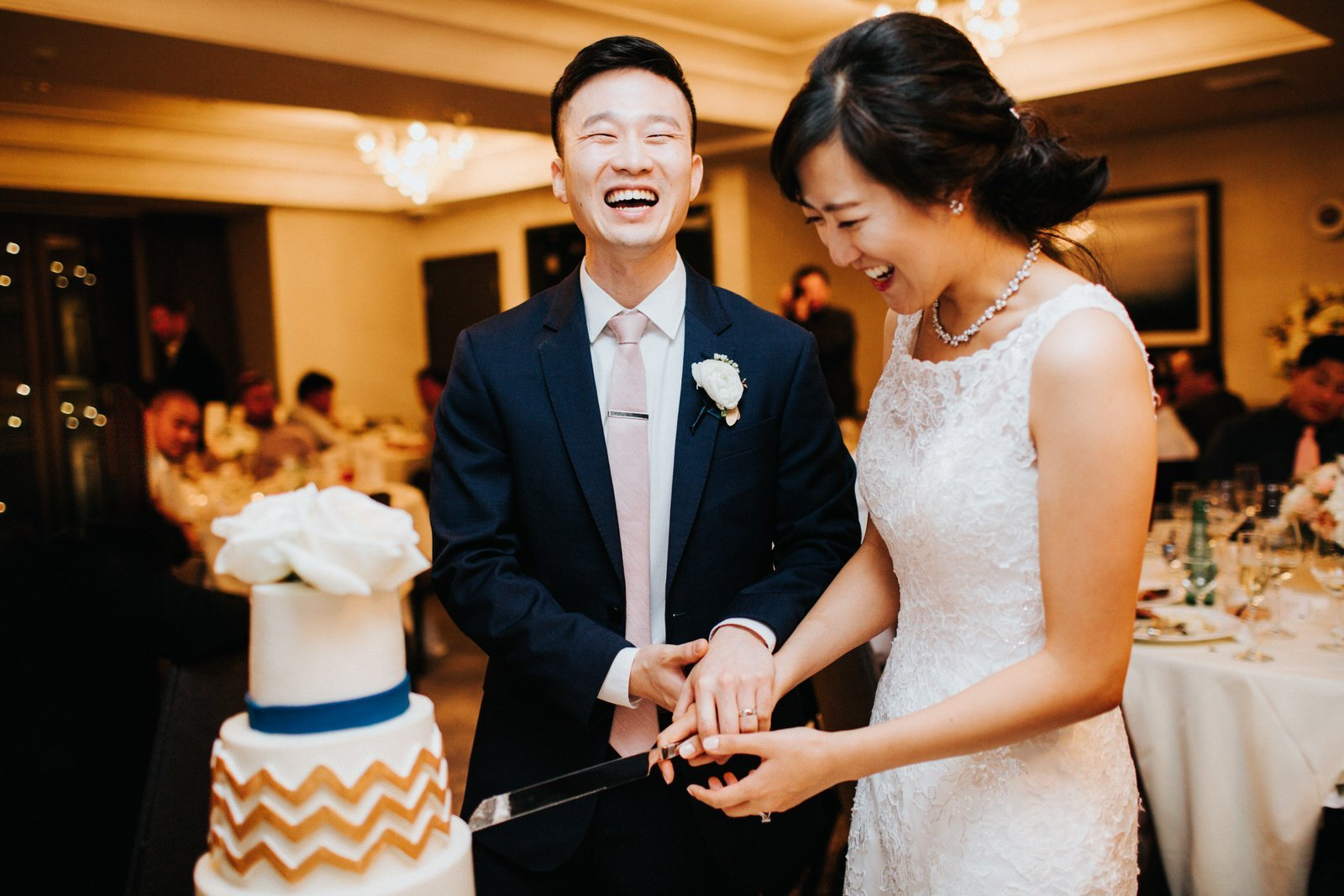 The couple cuts the cake during their reception at hotel 1000
