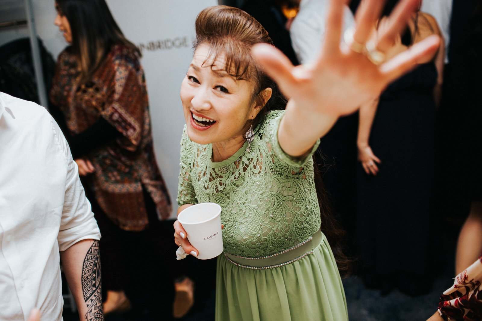 Guests laugh and party during the reception