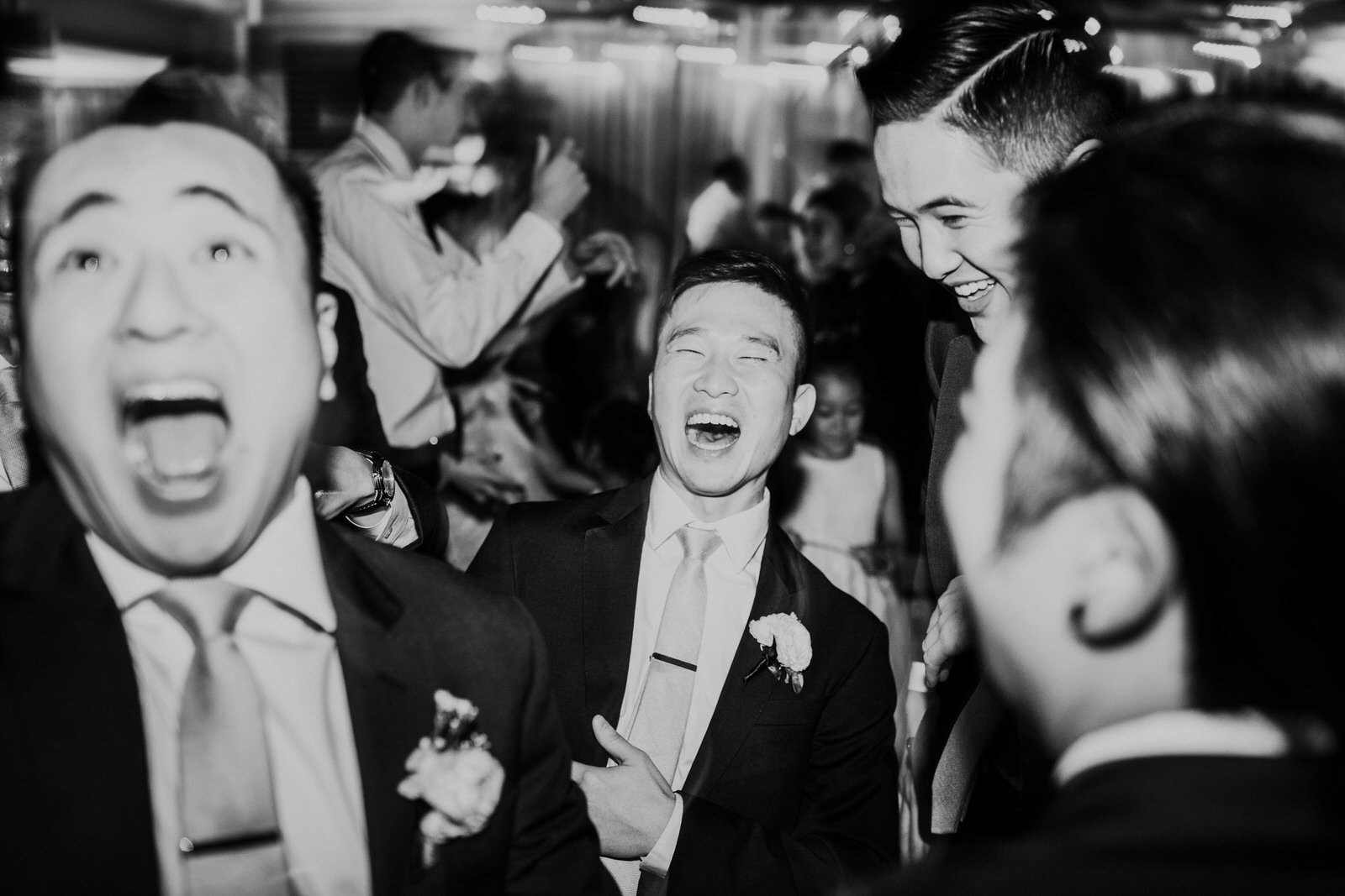 The groomsmen laugh during the reception
