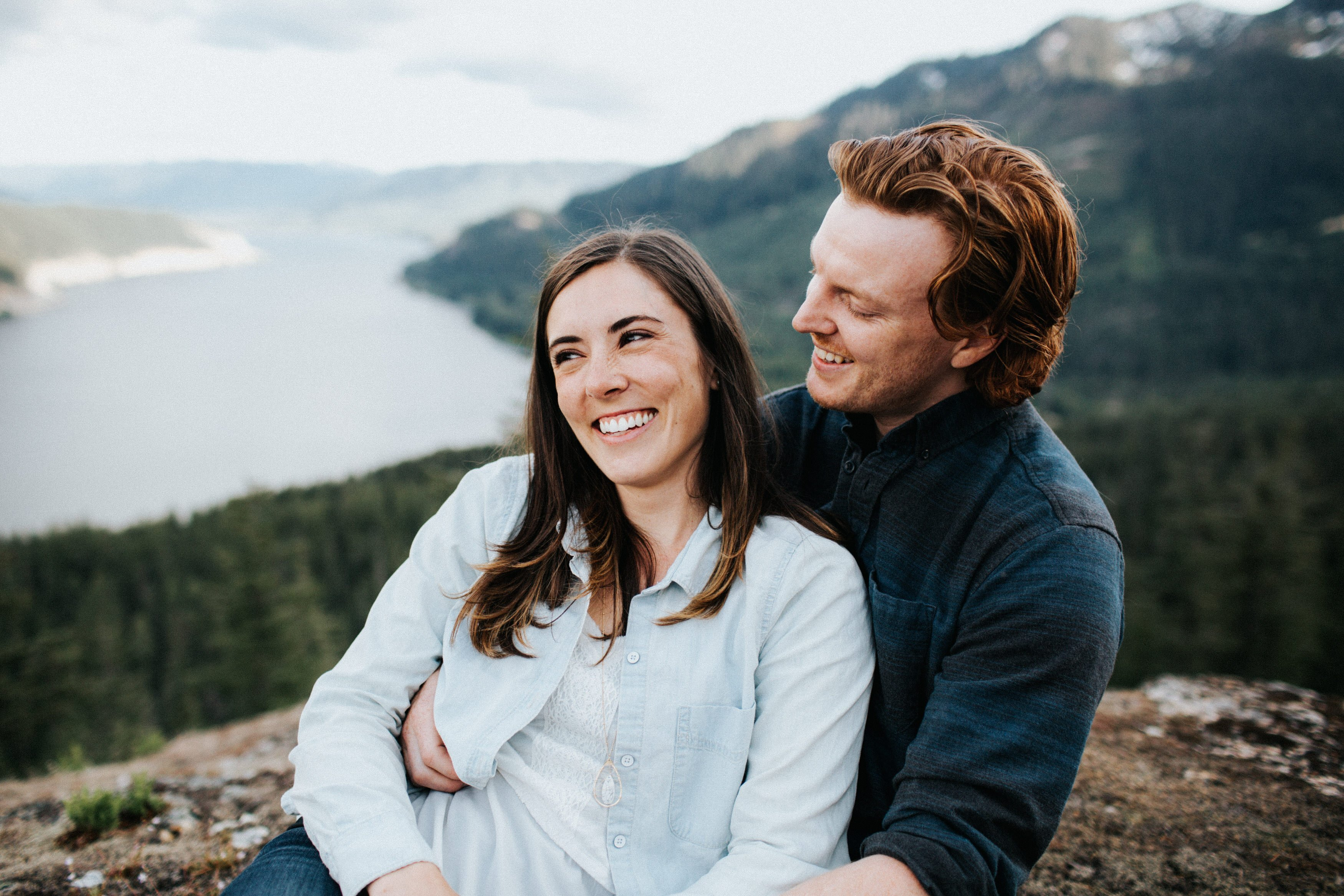 A couple laughs together and smiles during their pnw engagement session