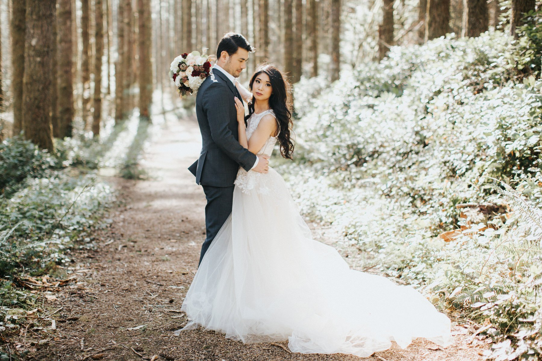 A gorgeous bride holds her flowers during her luxury engagement session in the mountains