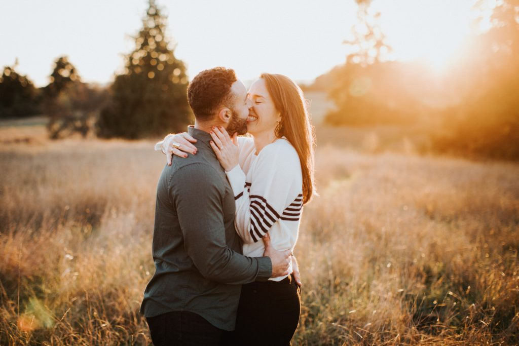 Beautiful sunset light at a discovery park engagement session in Seattle.
