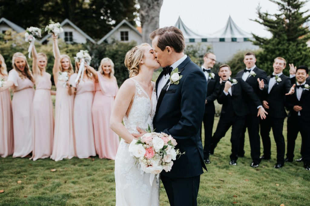 A couple kisses during their wedding at Roche Harbor Resort.