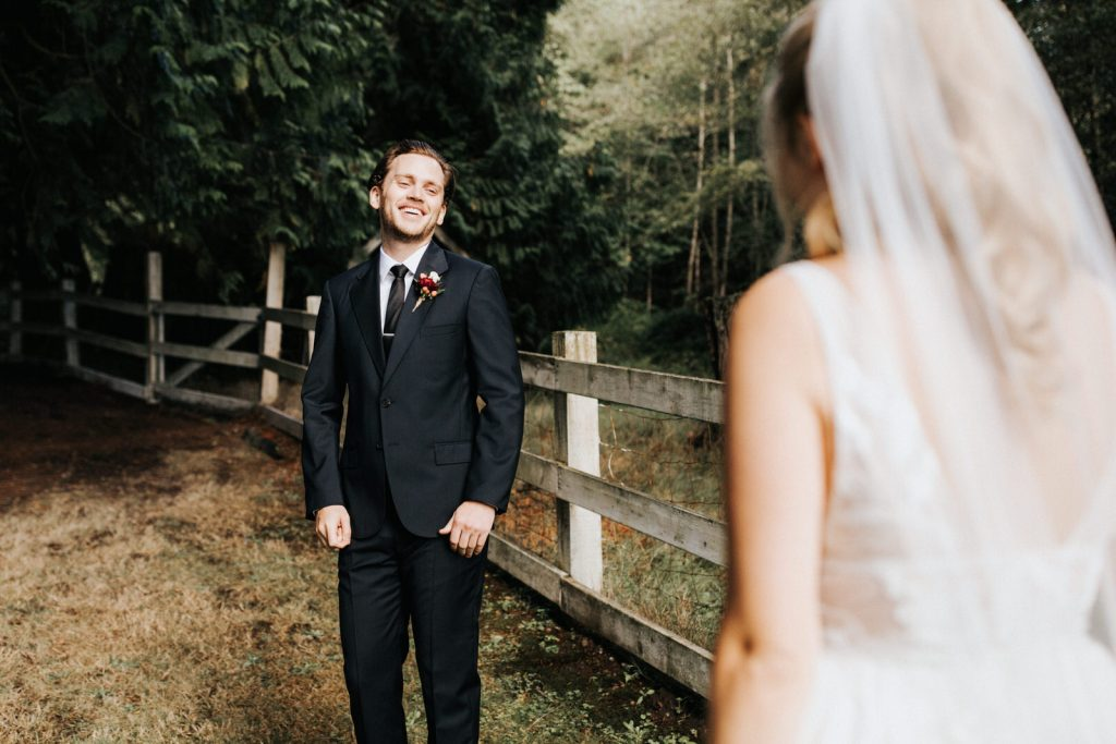 A groom is so excited to see his bride.