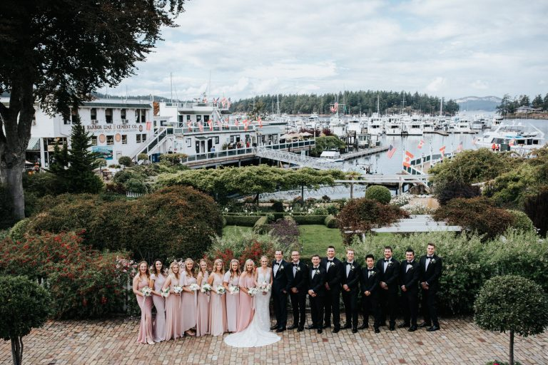 A wedding party poses at Roche Harbor Resort on San Juan Island