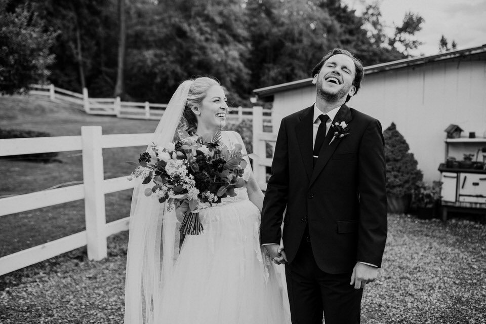 A couple laughs on their wedding day at Chateau Lill in Woodinville.