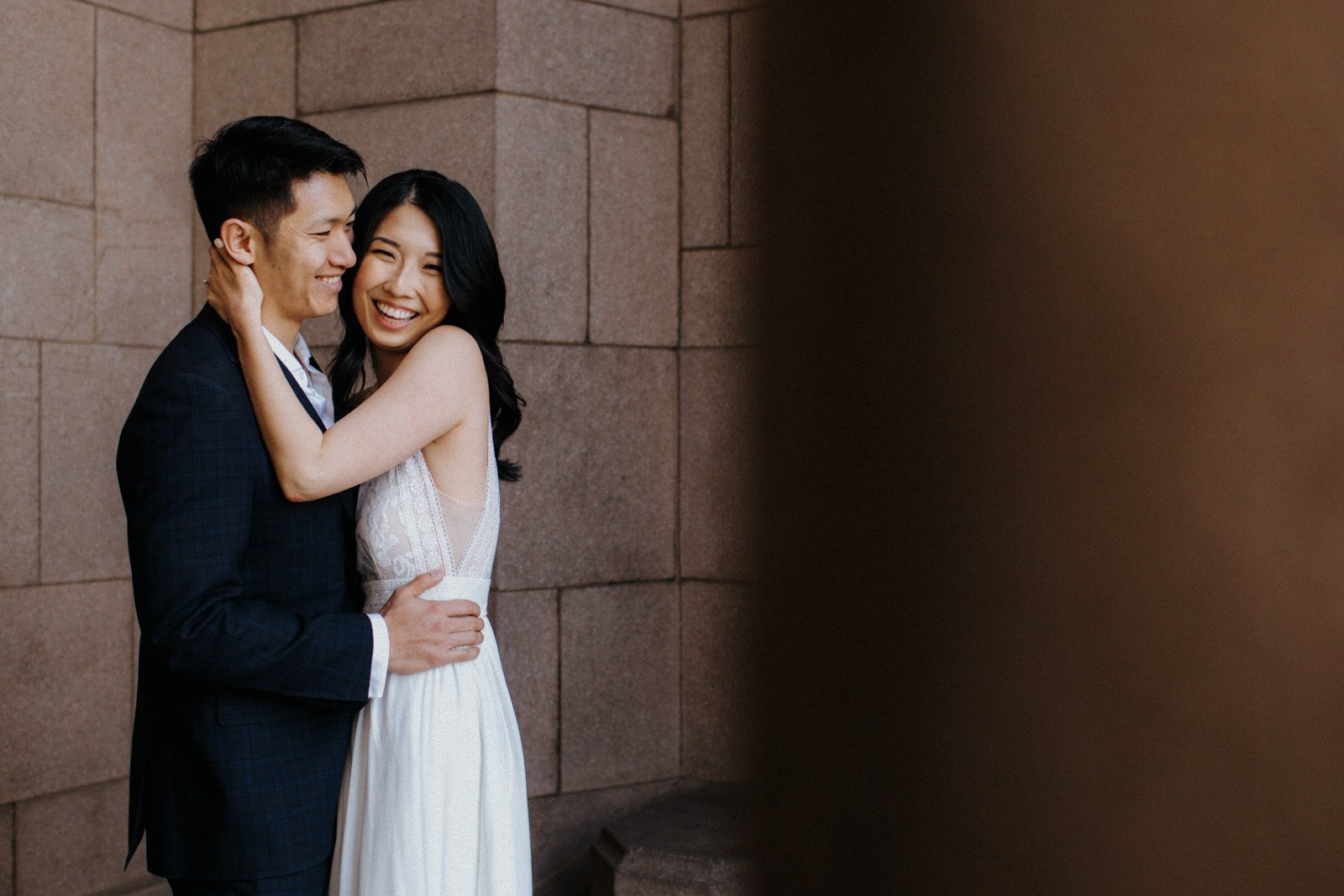 A couple laughs during their engagements session at UW