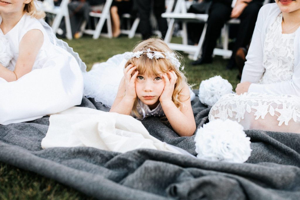 A bored flower girl is tired of the wedding at the Seattle Tennis Club.