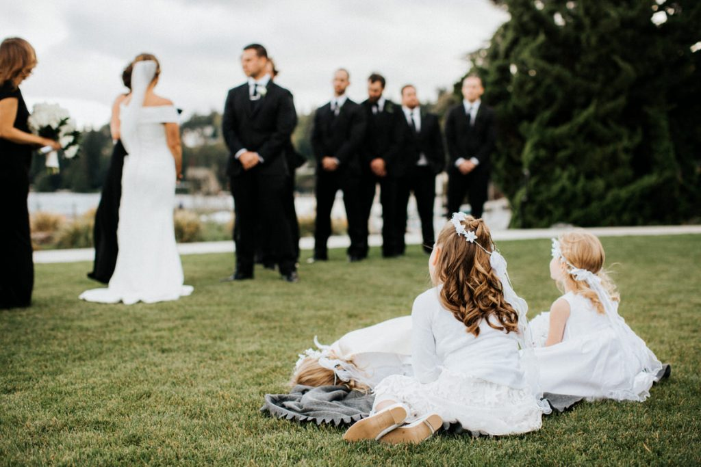 A group of kids watch a wedding at the Seattle Tennis Club.