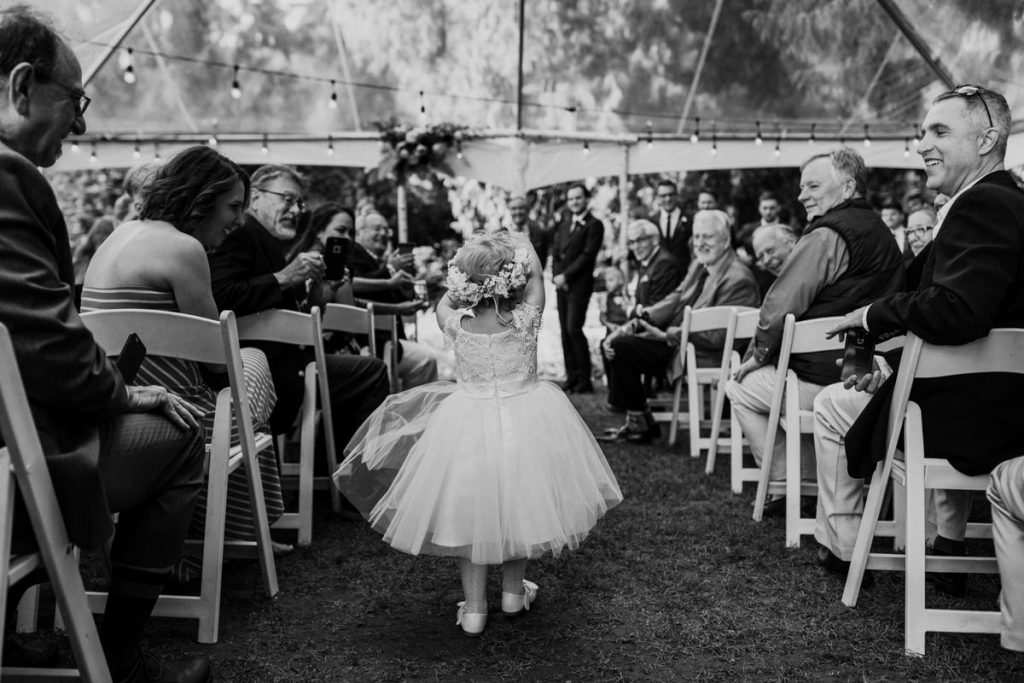 A young girl walks down the aisle during a wedding at Chateau Lill in Woodinville.
