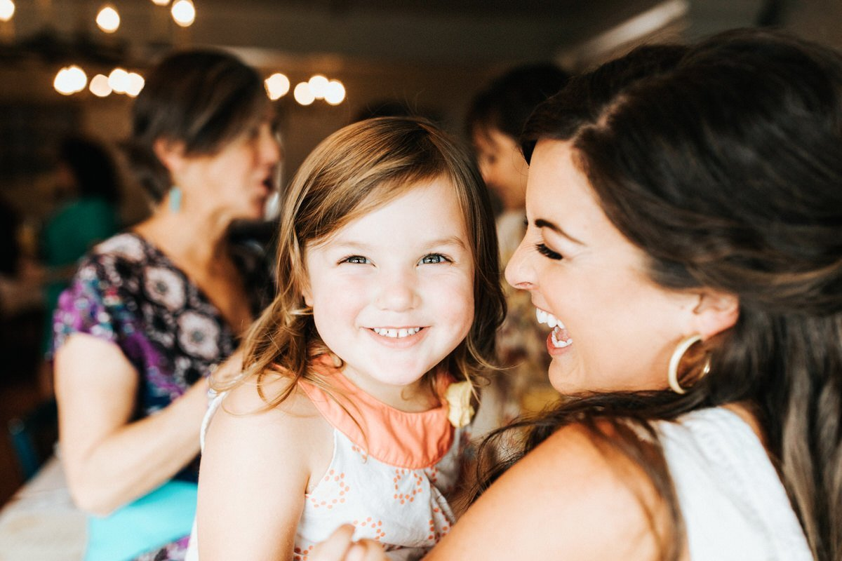 A mom and daughter laugh together.