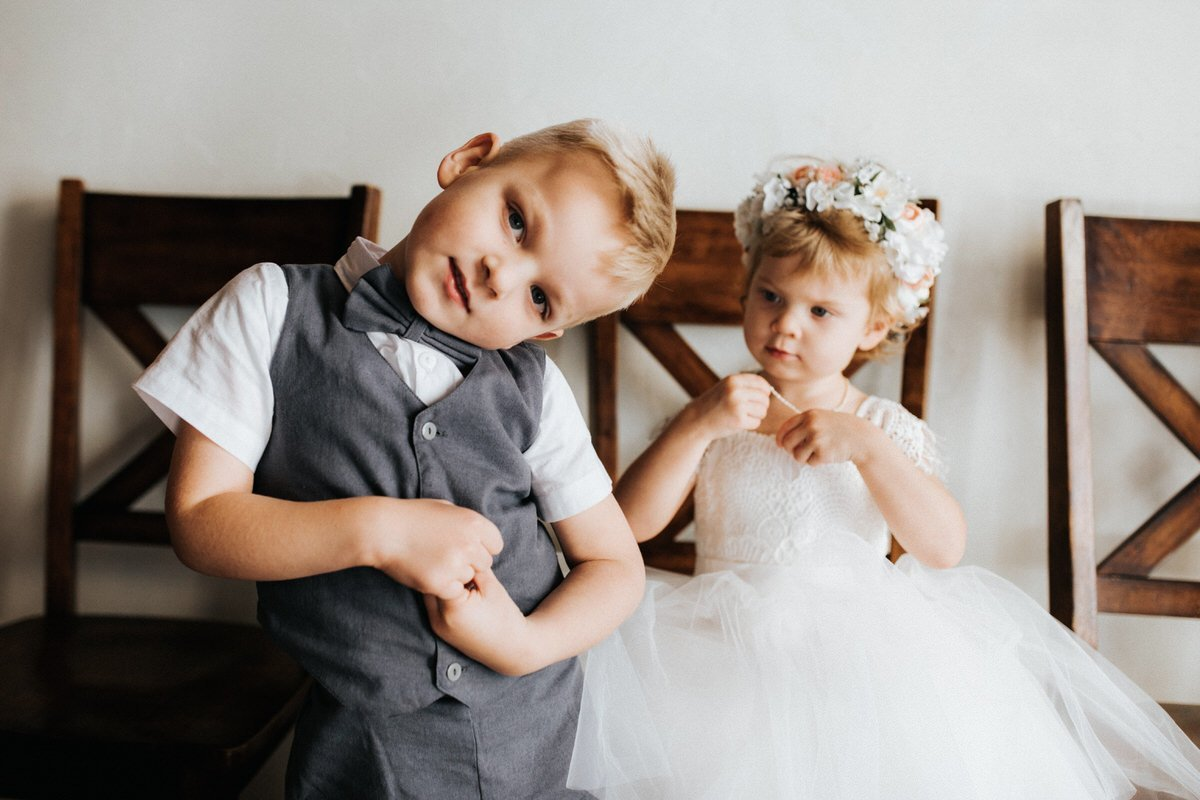 A ring bearer makes funny faces at Chateau Lill in Woodinville