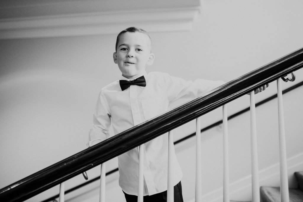 A kid smiles at the camera at a wedding at the Woodmark Hotel in Kirkland.