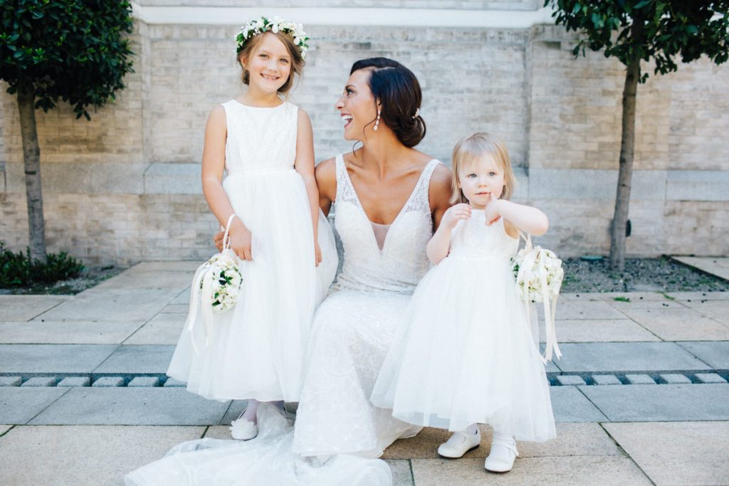 A gorgeous picture of a bride and two flower girls.