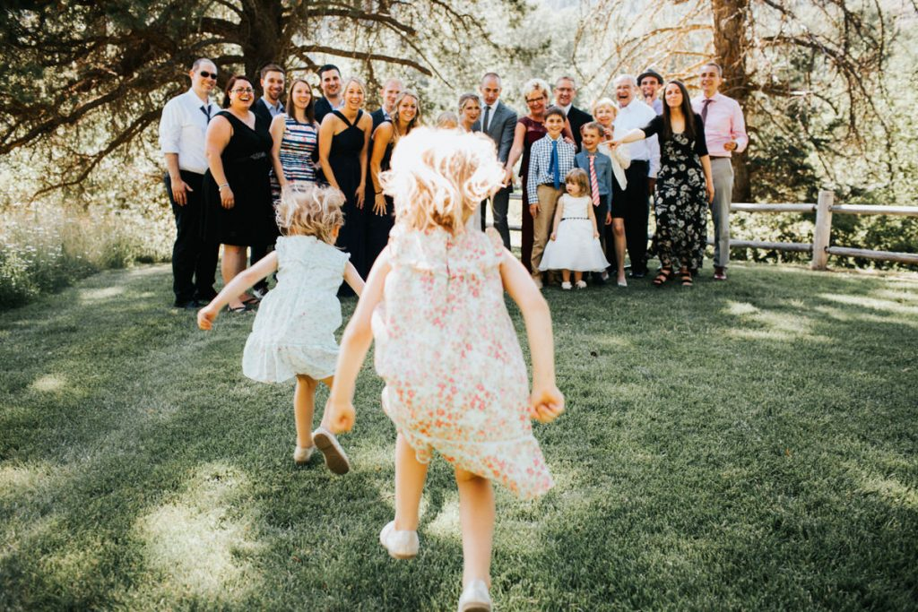 Kids being kids at a wedding, running and jumping and playing.