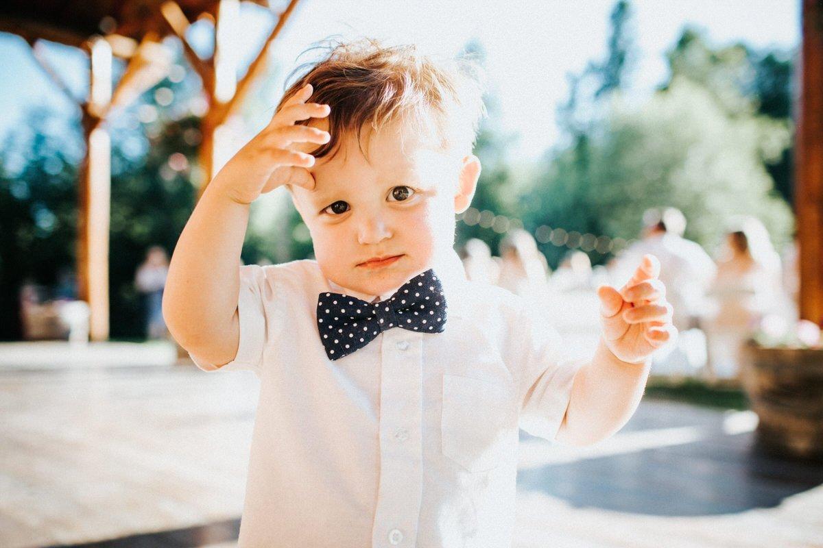 A cute kid smiles at the camera.