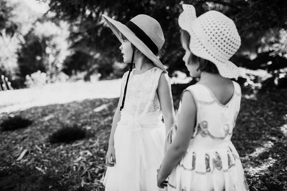 A timeless photo of two girls at a wedding.
