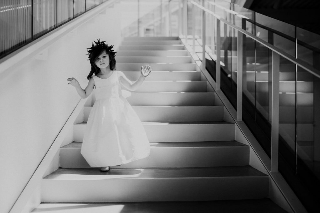 A flower girl dances in the light at a wedding in downtown Seattle.