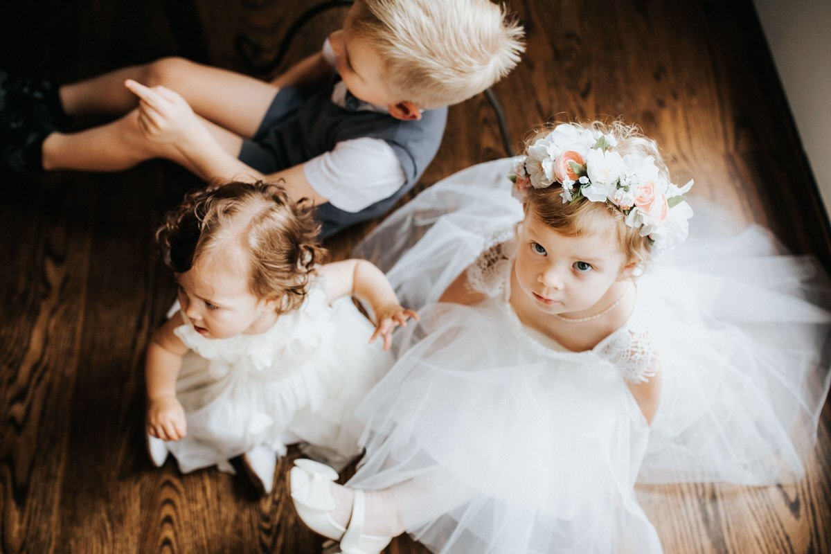 A group of kids sits during a wedding
