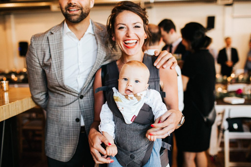 A happy family and their baby at a wedding reception in Seattle.