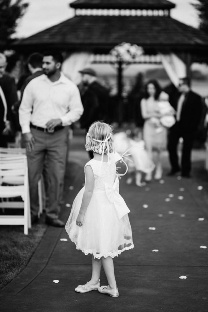 A girl stands in the aisle at a wedding in snohomish