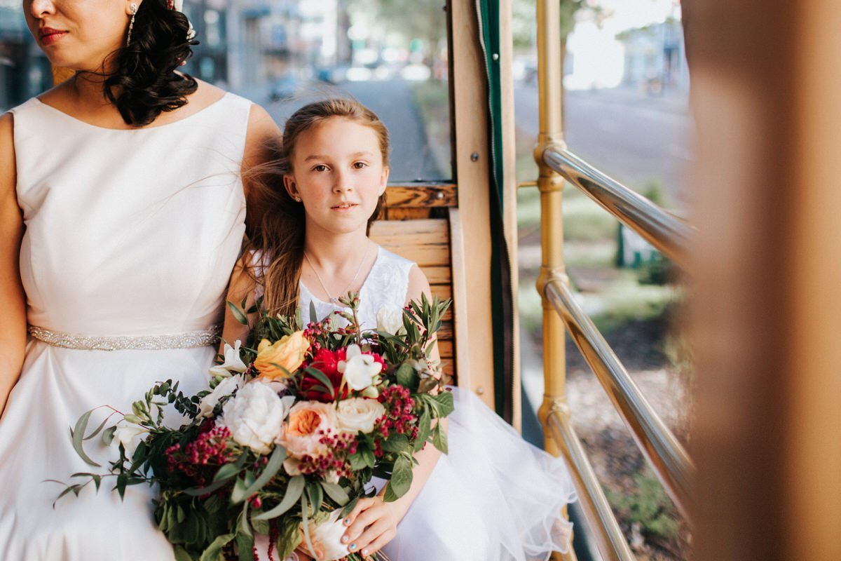A classic portrait of a flower girl on a trolly in Seattle