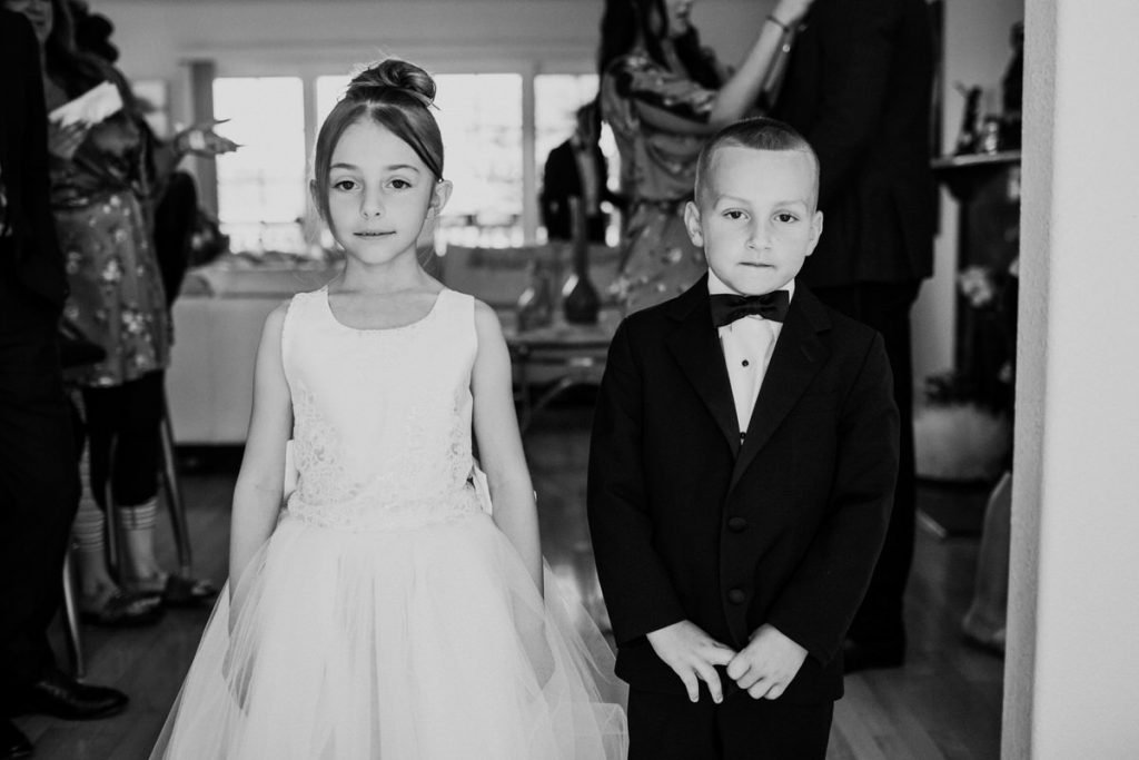 A ring bearer and flower girl pose for portraits at a wedding in San Francisco.
