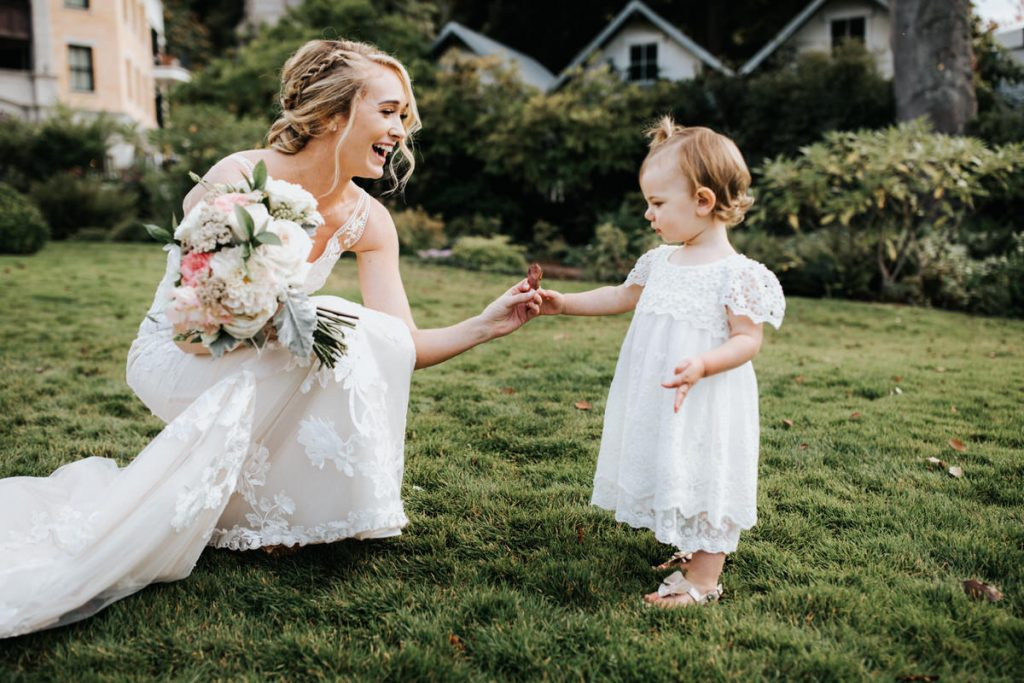A girl gives a bride a gift on her wedding day.