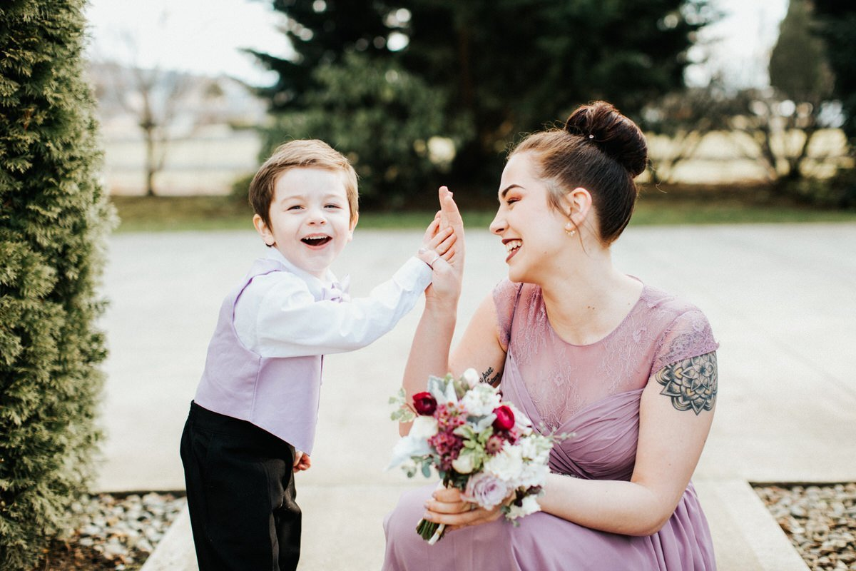 A son high fives his mom and laughs.