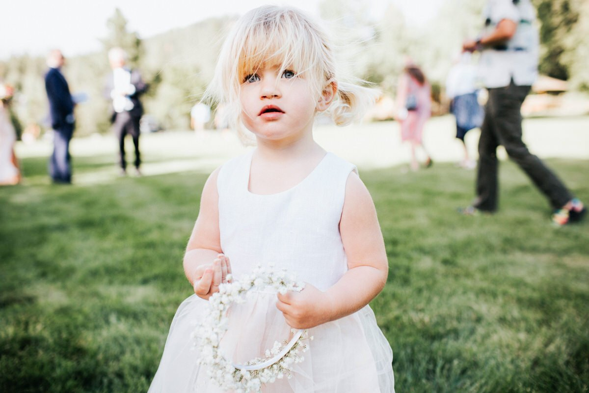 A girl holds her flower crown at a wedding in Mountain Springs Lodge in Leavenworth.