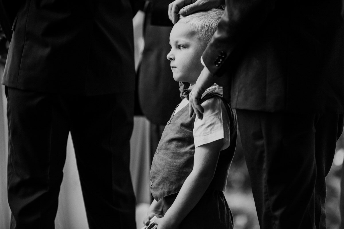 A portrait of a ring bearer during a wedding in Woodinville.